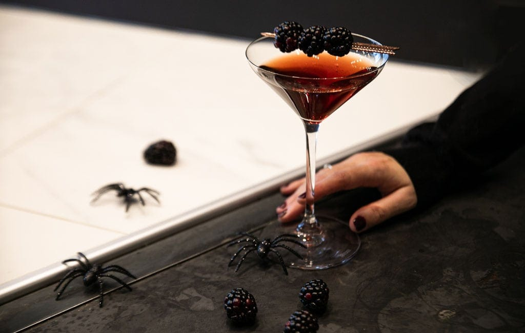 A powerful red cocktail based on Pur Vodka, inspired from the Cosmo, with the flavors of cranberry and pomegranate, perfect for fall and winter celebrations, as well as Halloween!